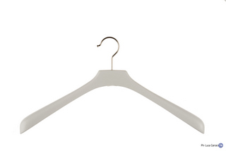 See Woman's white wooden hangers